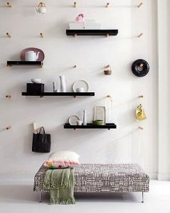 Channel your inner Puritan by using wooden pegs to hold up shelves.