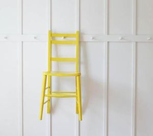 Keep floors uncluttered by storing furniture on hooks on the wall!