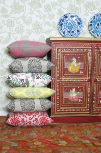 An Indian cupboard and Indian inspired scatter cushions.