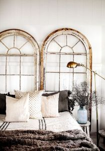 Magnificent window frames as a headboard.