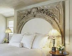 An exquisite wooden arch can be a statement headboard.