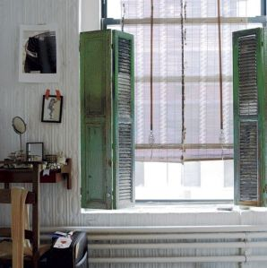 Salvaged wooden shutters in a chic modern interior.