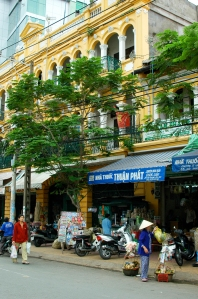All you need to when strolling around central Saigon is look up, and behind the chaos you'll see many beautiful colonial French shop fronts.