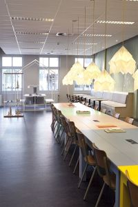 Hang several XL Origami Lights in Pure White above a long table to create warm task lighting.