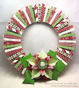 Cover clothes pegs with washi tape and clip them onto a round piece of cardboard to create a festive wreath for your door.