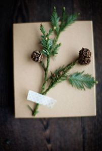 Spruce up gifts with sprigs of greenery fastened with washi tape.