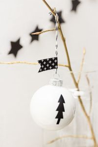Decorate tree baubles with washi tape.