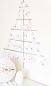 Create a washi tape Christmas tree, hang paper stars filled with little treats for each day leading up to Christmas.