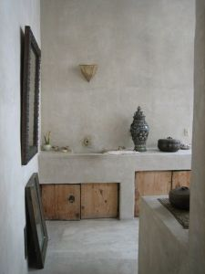 Simple concrete and wood bathroom is tasteful and textured.