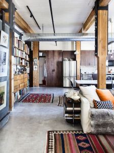 Wooden pillars and beams are complimented beautifully by the concrete floor.