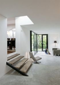 Reclaimed wooden steps with a concrete floor in a minimalist and modern interior.